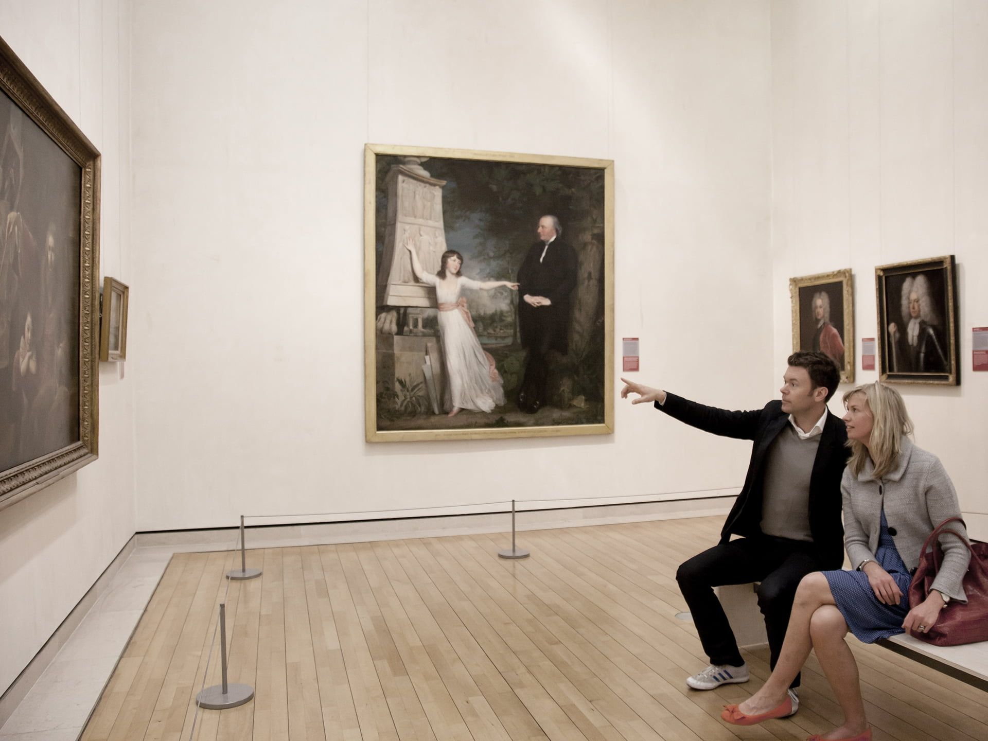 Couple looking at paintings in the National Gallery of Ireland